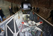 Celebrating the launch of the new Star Wars: Rise Against the Empire Play Set for Disney Infinity 3.0 - fans gathered to pose next to an epic piece of 3D artwork recreating the Death Star Trench Run featured in the game. London commuters today were unexpectedly immersed in an epic piece of 3D artwork underneath Southwark Bridge, to mark the launch of the new Rise Against the Empire Play Set for Disney Infinity 3.0: Play Without Limits. The artwork, created by world-renowned artists 3D Joe and Max, is a re-creation of the iconic Death Star trench run from Star Wars: A New Hope, and is featured in the Rise Against the Empire Play Set out Friday 2nd October, which features iconic moments from the original Star Wars trilogy. It is open to the public from 8am – 8pm on Thurs 1st and Fri 2nd October.